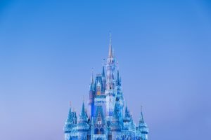 Beautiful sky turning to night with the Disney castle sparkling with twinkle lights. a magical sight.